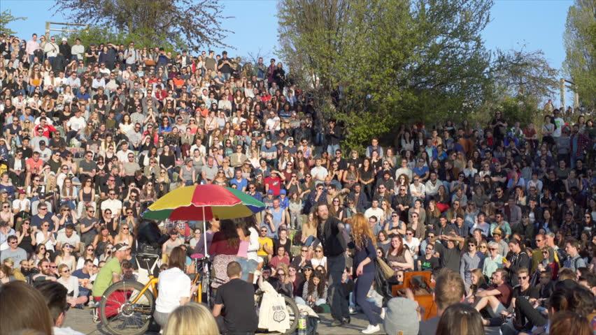 GERMANY - CIRCA APRIL 2017 - People dance sing Karaoke, huge audience crowd, sunny day, Mauer Park, Berlin