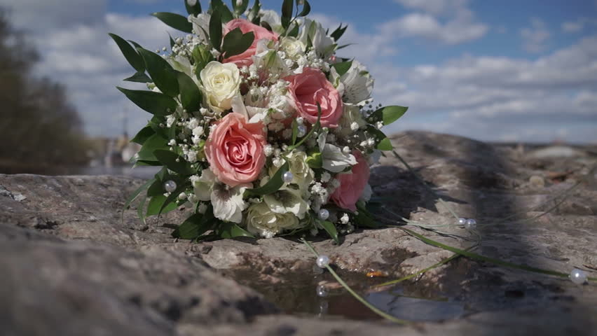 Wedding Bouquet On The Stone. Cloudy Sky Background | Shutterstock HD Video #10109639