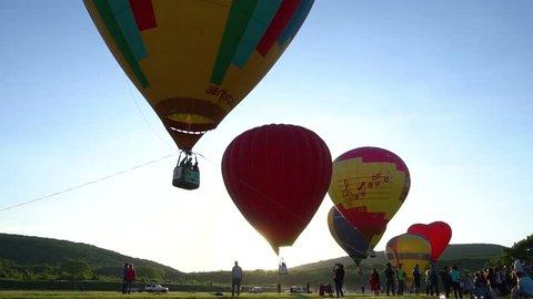 "Hot Air Baloons Flight Over Beautiful Autumn Forrest At Sunet. Russia, Krasnodar region, city of Abinsk. The festival of Aeronautics ""Abinskiy Riviera"" may 12, 2018"