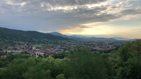 View on Bergamo at sunset, Lombardy, Italy.Bergamo is an Italian city northeast of Milan, in the Lombardy region. Its older upper district, called Citta Alta, is characterized by cobblestone streets.