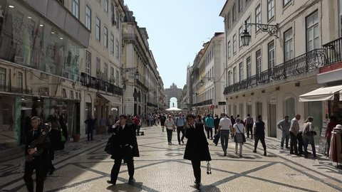 City Of Lisbon Downtown Rua Augusta. LISBON, PORTUGAL - 25 APRIL 2018; Crowd of people walking at famous Augusta street in downtown Lisbon, Portugal.