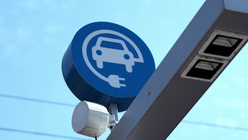 Charging devices for electric cars at exhibition of electric cars. refueling an electric car in the parking lot. | Shutterstock HD Video #1011120080