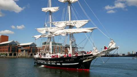 Belfast, Northern Ireland, UK- May, 17, 2018: TS Royalist, Sea Cadets flagship, manoeuvres prior to docking. Royalist is visiting for the Belfast Titanic Maritime Festival over the weekend.