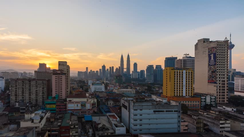 Time lapse of sunrise in Kuala Lumpur, Malaysia. High quality, Ultra HD, 4K resolution. Zoom Out motion timelapse.
