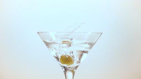Romania - September, 2017: Olive falling into Martini glass