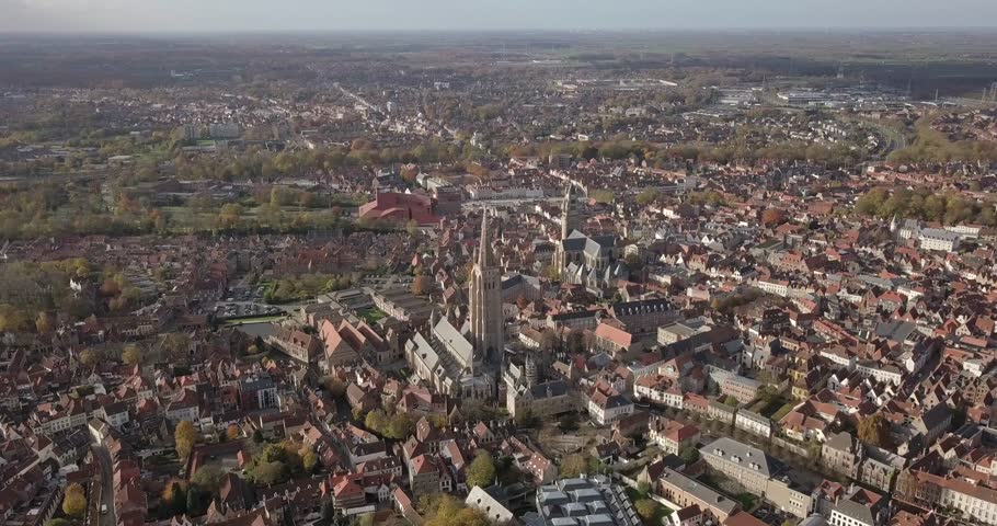 Aerial Panoramic Pan shot over Bruges Belgium, revealing Church of our Lady and Saint Salvator Cathedral #1011211310