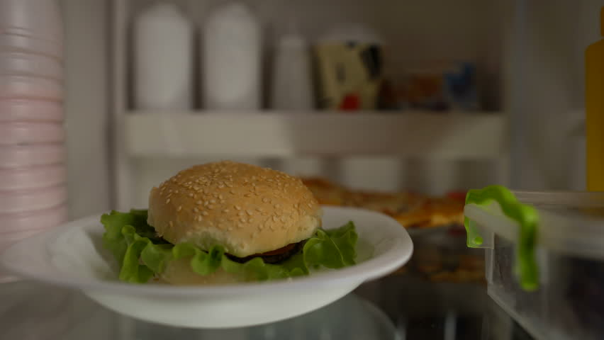 Addicted to fast food male eating fridge burger at night, unhealthy lifestyle | Shutterstock HD Video #1011222590