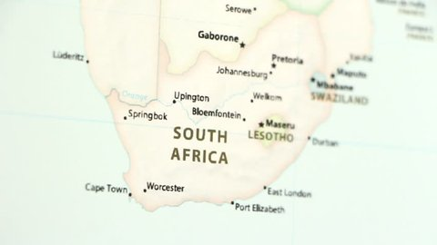 South Africa on a political map of the world. Video defocuses showing and hiding the map.