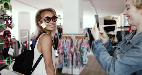Millennials looking at smartphone in a vintage store