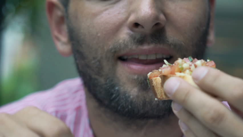 Close up of male mouth eating sandwich, super slow motion 120fps  | Shutterstock HD Video #1011288440