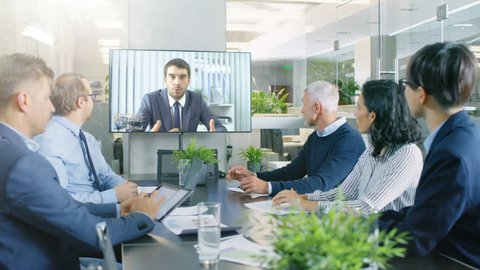 In the Conference Room Board of Directors Have Video Call with Foreign Inverstor. Business Meeting with Big Merger Discussion.