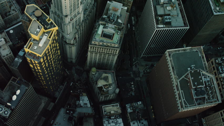 Top-down aerial view of a large city. Flying over skyscrapers in New York. Shot with a RED camera.