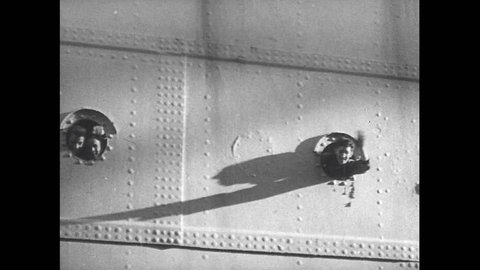 1940s: Man waves from porthole on ship. People on ship. Shadow of stretcher carried down gangplank cast. Men carry injured soldiers  on stretchers.