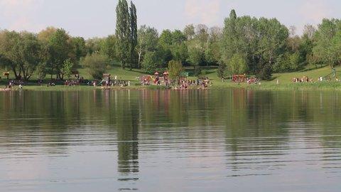 Swimming in water reservoir Benedikt in city Most, Czech Republic