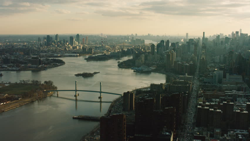 Aerial view of New York City. Flying over river and buildings at sunset. Shot with a RED camera. | Shutterstock Video #1011423530