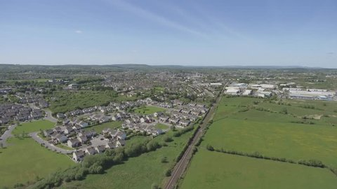 aerial birds eye from outside ennis county clare. ennis skyline with housing estate on a sunny day.