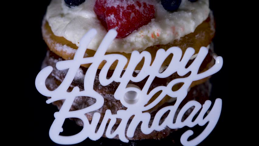 Cake and skull in a festive cap on a black background. 4k, dolly shot, defocusing, blur. | Shutterstock HD Video #1011463250