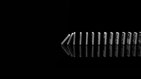 Medium tracking shot of white dominoes falling in a row in slow motion from left to right. Camera moves sidewards from left to right.
