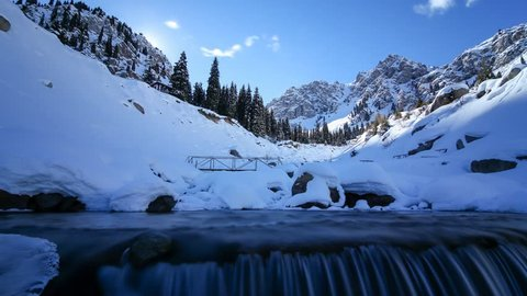 A time lapse tracking shot of Winter in mountains / Almaty Kazakhstan