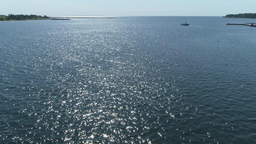 Drone flight over Jutland water, Denmark | Shutterstock HD Video #1011502340