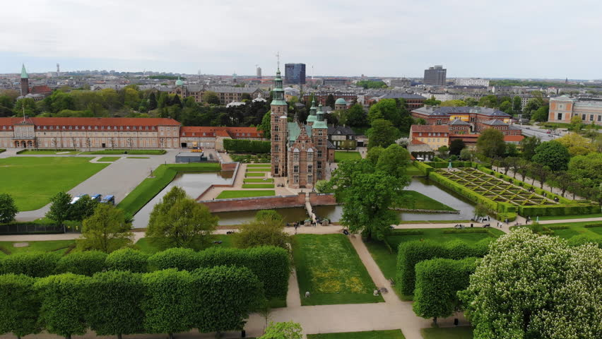 Aerial view of Rosenborg Castle (renaissance style palace) situated in The King's Garden (Kongens Have) - central Copenhagen, capital city of Denmark from above | Shutterstock HD Video #1011516230