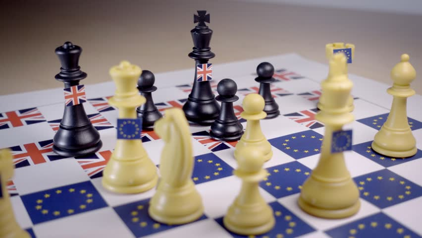 Chess board with European Union and Great Britain pieces, checkmate with the white EU queen. Brexit negociations and strategy concept.