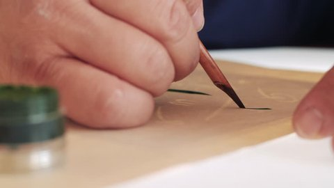 Calligrapher writes canvas pen.