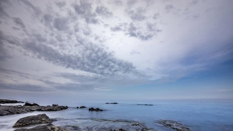 Timelapse video the costa del sol in Fuengirola Mijas costa , beautiful rocks and clouds.
