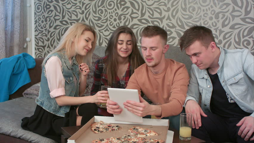 Four hipsters communicate via video conference using tablet #1011599990