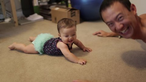 Dad and Baby Playing During Tummy Time