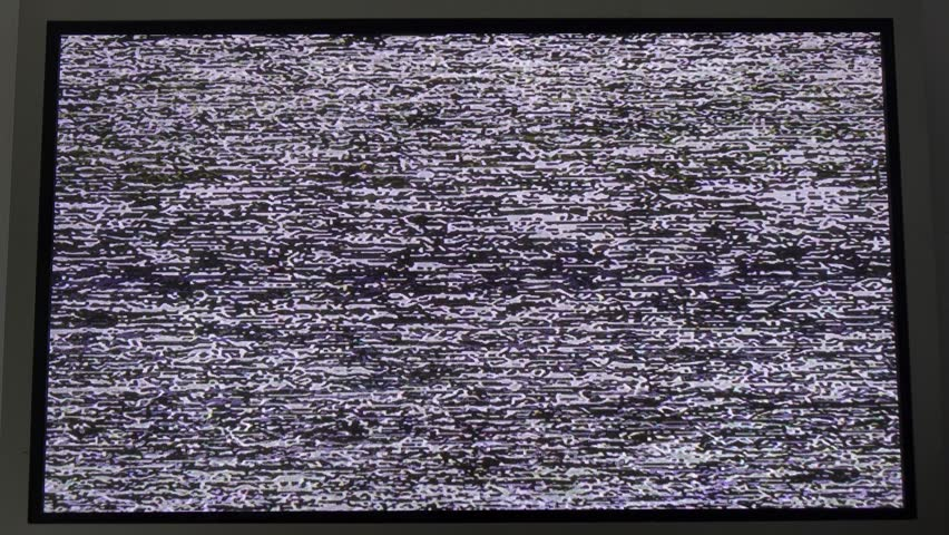 Noise signal on the screen.Flickering analog TV signal with bad interference. | Shutterstock HD Video #1011679460