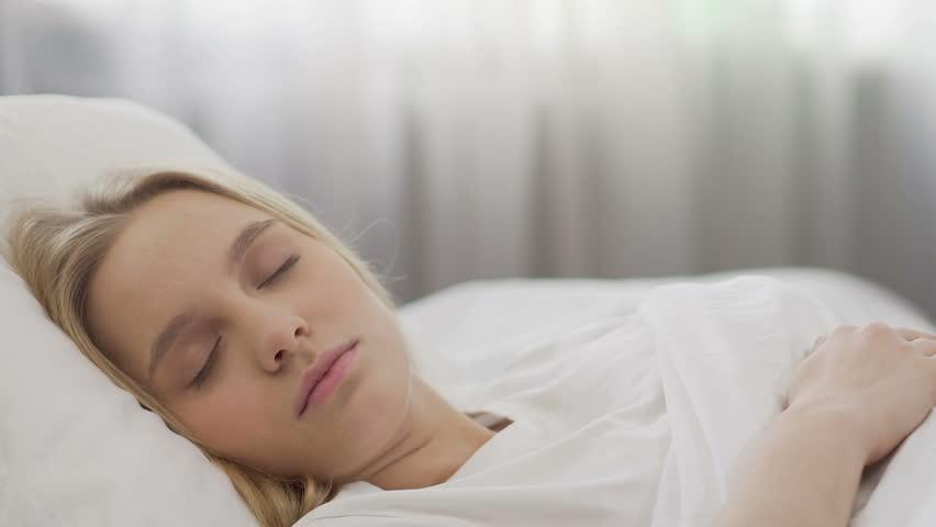 Smiling teenage girl waking up, beginning of summer holidays, happy morning   Shutterstock HD Video #1011682340
