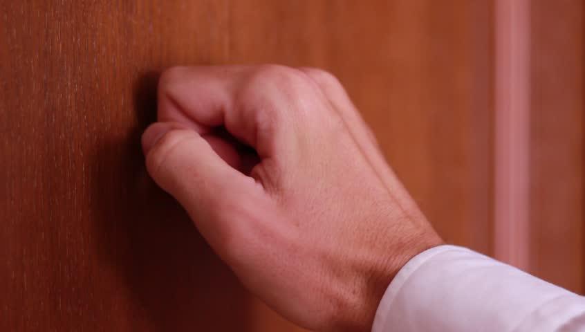 Male hand knocking on wooden door | Shutterstock HD Video #1011706190