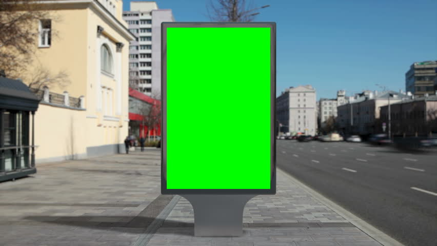 Street billboard stand with green screen on time lapse city background. Seamless loop. | Shutterstock HD Video #1011711620