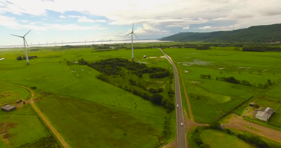 Rio Grande do Sul, Brazil 2018: Aerial view of wind turbines in southern Brazil. Drone footage of a wind farm located in southern Brazil. Overlooking the wind turbine farm and a nearby highway road.