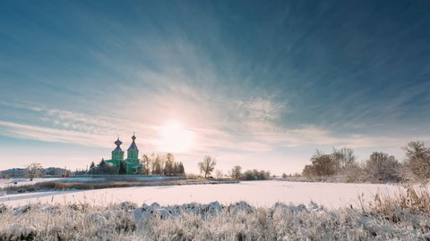 Village Krupets, Dobrush District, Gomel Region, Belarus. Time Lapse Timelapse Time-lapse Of Old Wooden Orthodox Church Of The Holy Trinity Sunny Winter Day. Historical Heritage