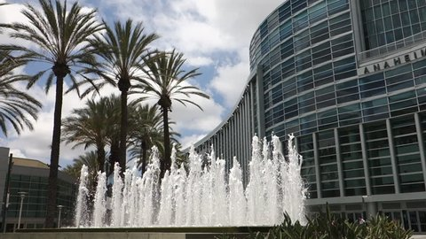 A slow pan down from the top of the Anaheim Convention Center to the beautiful fountain