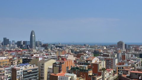 Aerial Pan right footage of Barcelona skyline on a beautiful day