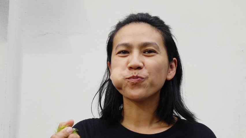 Women eating rambutan fruit