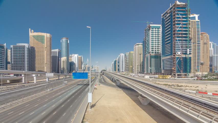 Amazing top view on Sheikh Zayed road surrounded Dubai Marina and JLT skyscrapers from bridge, Dubai. Traffic and metro line. United Arab Emirates