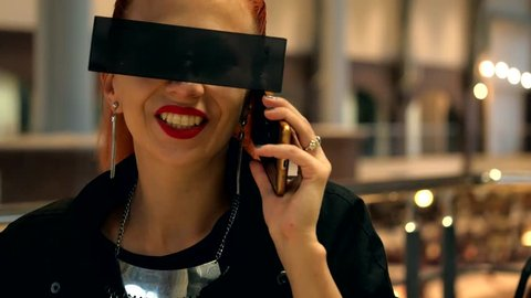 Fashion pretty red hair stylish woman with black sunglasses talks with here friend by mobile phone close-up