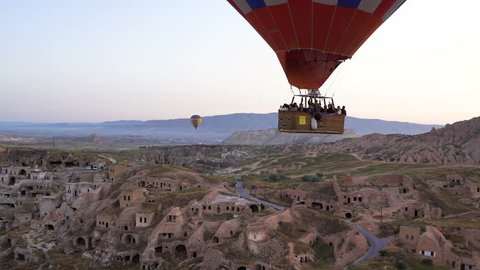 Lots of hot air balloons flying over valleys in Goreme, Turkey Flying over the Ancient Cave City in Rose Valley.