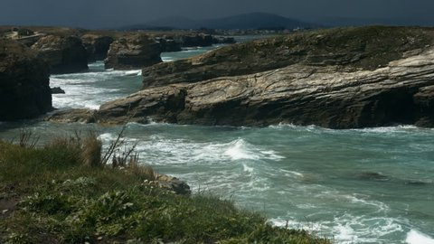 Stunning clips and strong waves view from the top of a cliff. Cliff view at Costas do Catedrais in Galizia, Spain