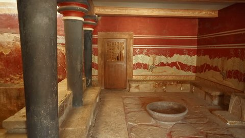 The Throne Room in the Minoan Palace of Knossos, Heraklion, Crete, Greece flanked by a beautiful Griffin couchant fresco. Knossos is the largest Bronze Age archaeological site in Crete.