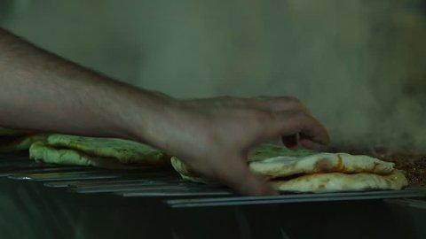 Turkish kebap preparing. Man hand preparing traditional delicious turkey shish kebab skewer made of meat. Cooking.