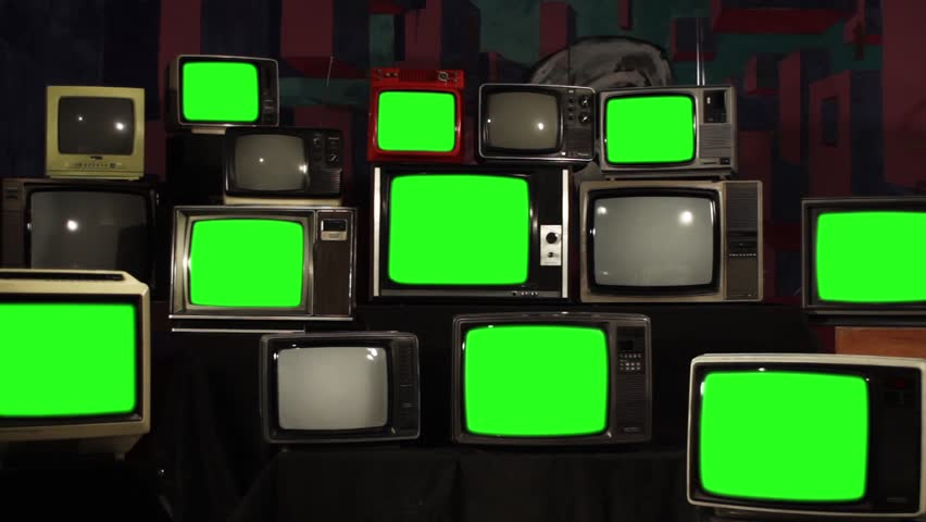 Many Tvs With Green Screens. Aesthetics of the 80s. Zoom In. Ready to Replace Green Screens with Any Footage or Picture you Want.  | Shutterstock HD Video #1012046270