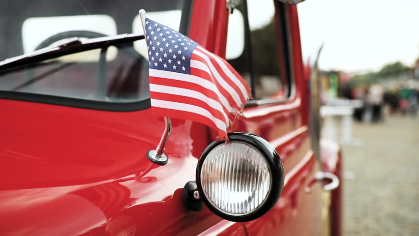 Close Side View Of Red Pickup Truck With Small American Flag Waving In Slo-mo Slow Motion | Shutterstock HD Video #1012052780