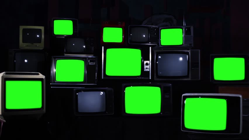 Many Tvs With Green Screens Turning Off. Zoom In. Blue Steel Tone. Aesthetics of the 80s. Ready to Replace Green Screens with Any Footage or Picture you Want.  | Shutterstock HD Video #1012059950