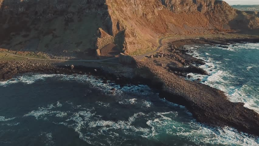 4k Aerial Shot of Giant's Causeway rocks in Northern Ireland | Shutterstock HD Video #1012074530