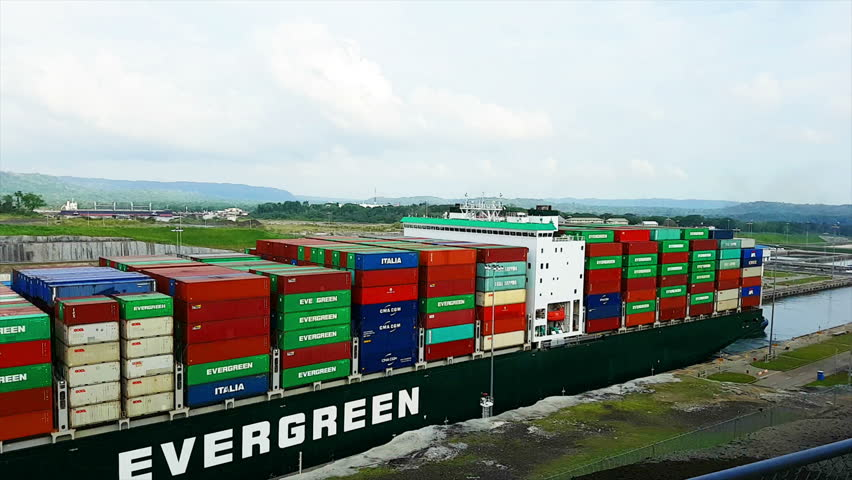 Colon, Panama; 04 27 2018: A ship of Evergreen passing through the Panamá canal with containers. | Shutterstock HD Video #1012076870